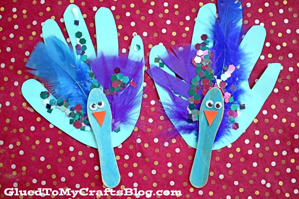 Scoop Stick Handprint Peacock Puppet - Kid Craft