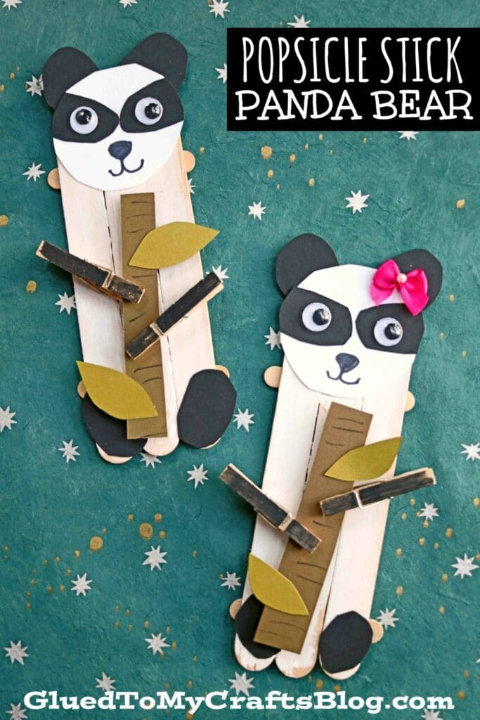 "My favorite part of this panda bear inspired kids craft idea is the fact that these craft stick and paper creations are holding a small stick of bamboo in their clothespin ""hands."""